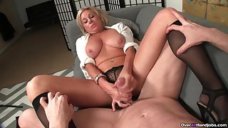 Mature blonde spreads her legs to tease and strokes a dick