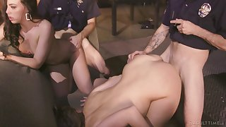 Two cops take advantage of two hotties that happen to be in the wrong place